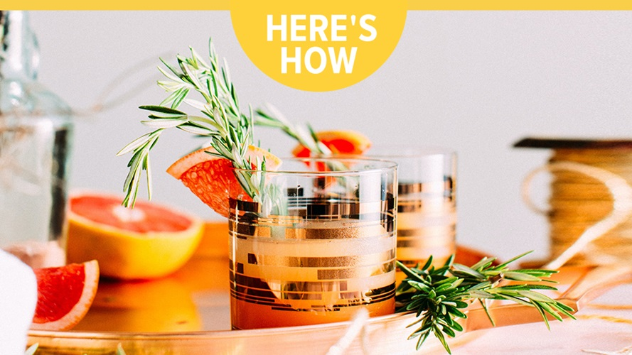 A couple drinks topped with sage and grapefruit. Includes text that reads, `Heres how`.